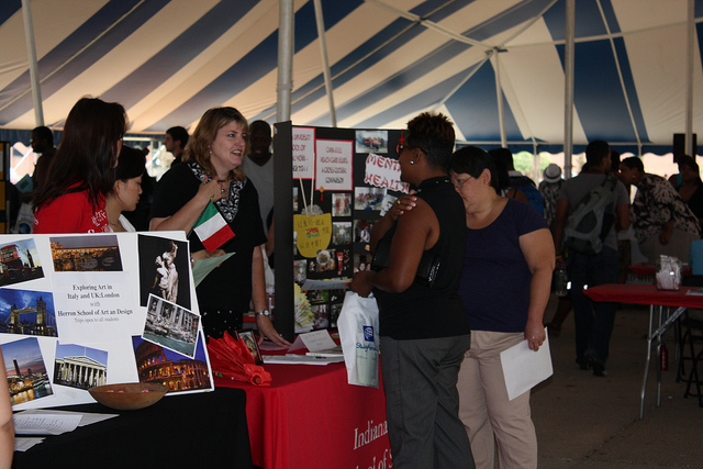 Students and staff at a study abroad fair.
